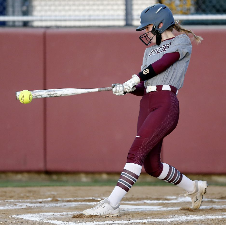 Heritage third baseman Riley Lunsford (10) gets a hit in the second inning as Heritage High School hosted Memorial High School for the District 9-5A softball championship in Frisco on Tuesday, April 20, 2021. (Stewart F. House/Special Contributor)