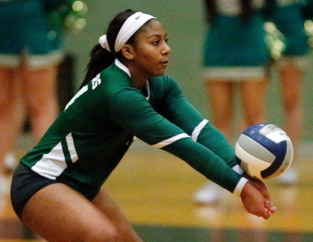 Lebanon Trail High School outside hitter Rayna Williams (14) takes a serve during game two as Lebanon Trail High School played Highland Park High School in a Class 5A Region II quarterfinal match played at Richardson Berkner High School on Monday night, November 12, 2019. (Stewart F. House/Special Contributor)