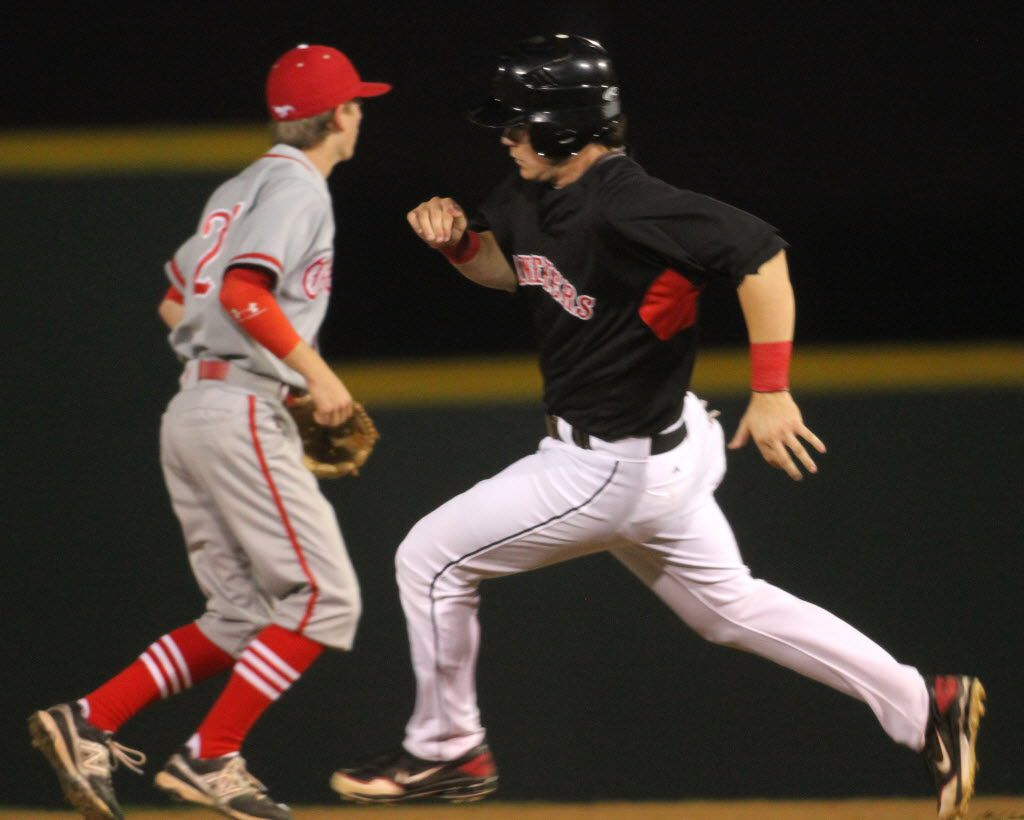 Colleyville Heritage first baseman Preston Palmeiro (25) sprints around second base and Grapevine shortstop David Fry (2) enroute to scoring the game's tying run on a hit and run in which he scored from first base during fourth inning action of their game. The two teams played their District 6-5A baseball game at Colleyville Heritage High School in Colleyville on April 9, 2013. (Steve Hamm/Special Contributor)