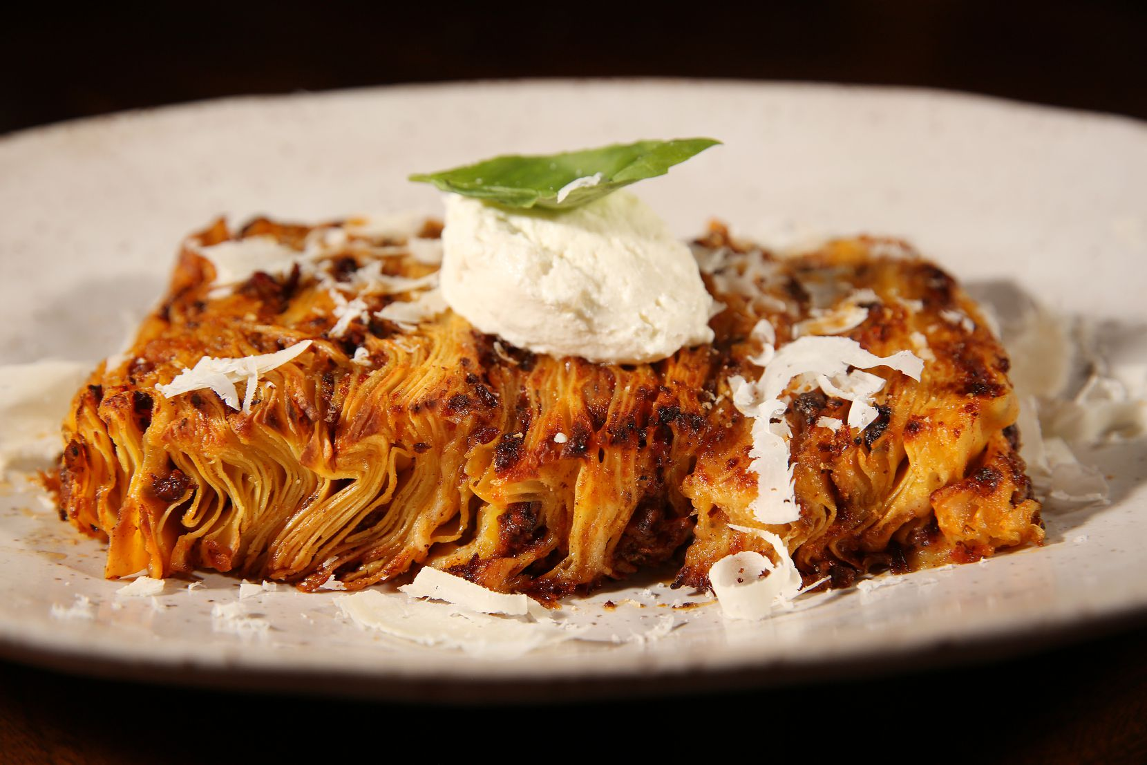 At Fachini, two portions of 50 layers of lasagna are made separately and then placed one on top of the other.