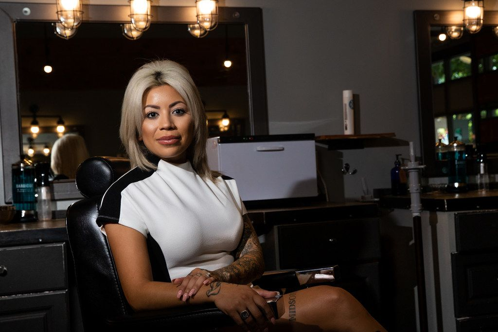 Lilly Benitez, the owner and founder of Blade Craft Barber Academy, poses for a portrait at the Blade Craft Barber Academy in the Deep Ellum neighborhood of Dallas on Thursday, Aug. 1, 2019.