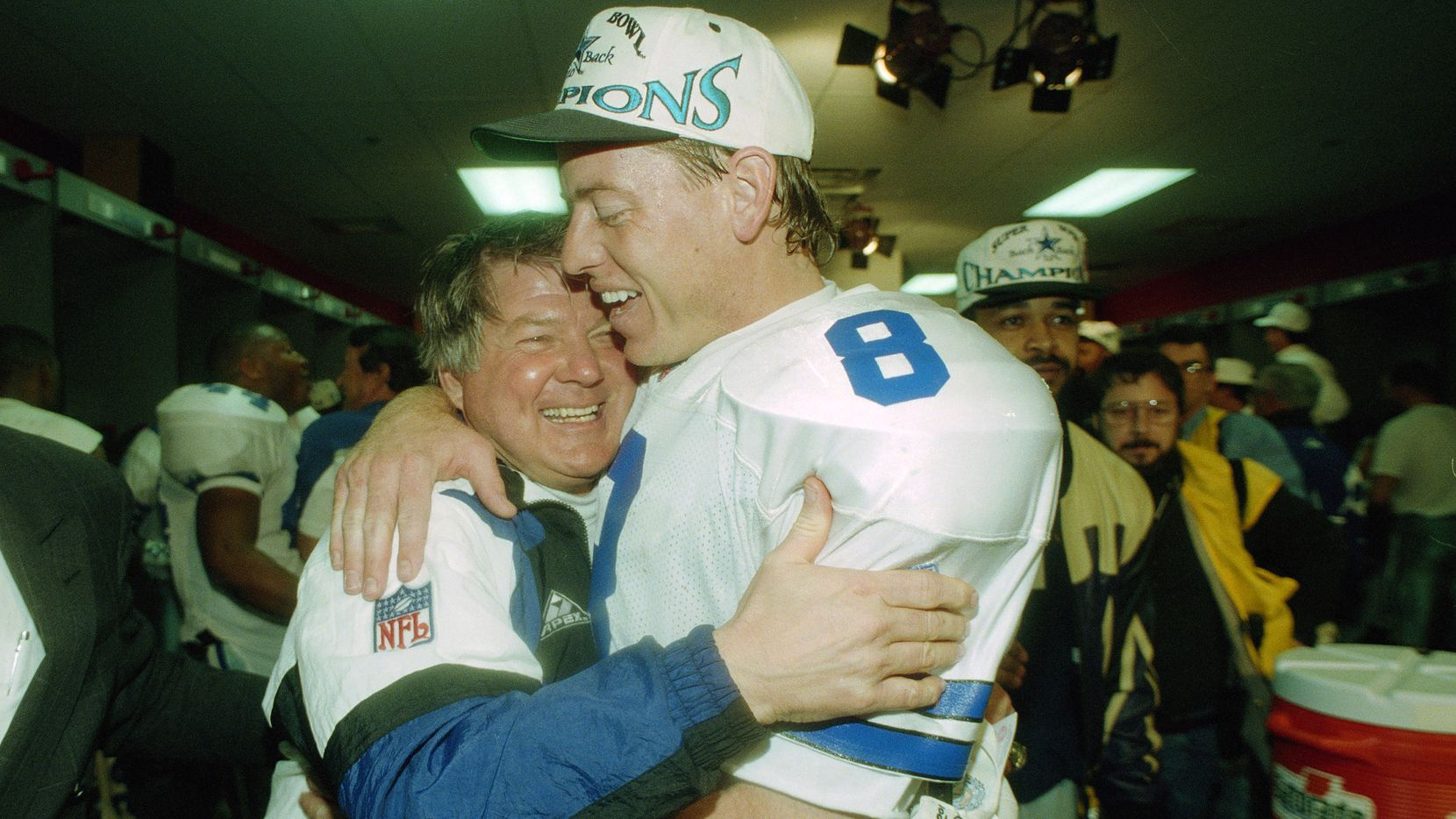 In this Jan. 30, 1994, file photo, Dallas Cowboys' head coach Jimmy Johnson hugs quarterback Troy Aikman in their locker room after defeating the Buffalo Bills 30-13 in Super Bowl XXVIII at the Georgia Dome in Atlanta. There's plenty of room for debate over the best first-round pick in the history of the Dallas Cowboys.