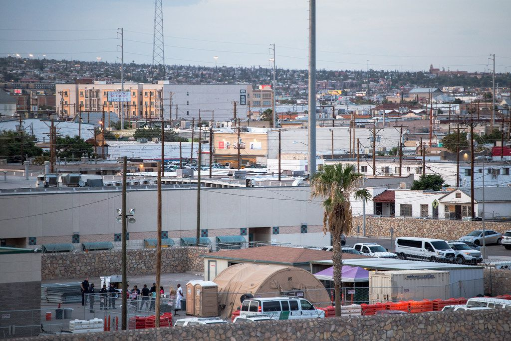 U.S. Customs and Border Protection agents stand by a group of people at a facility near the Paso del Norte Bridge in El Paso on Wednesday, July 31, 2019.