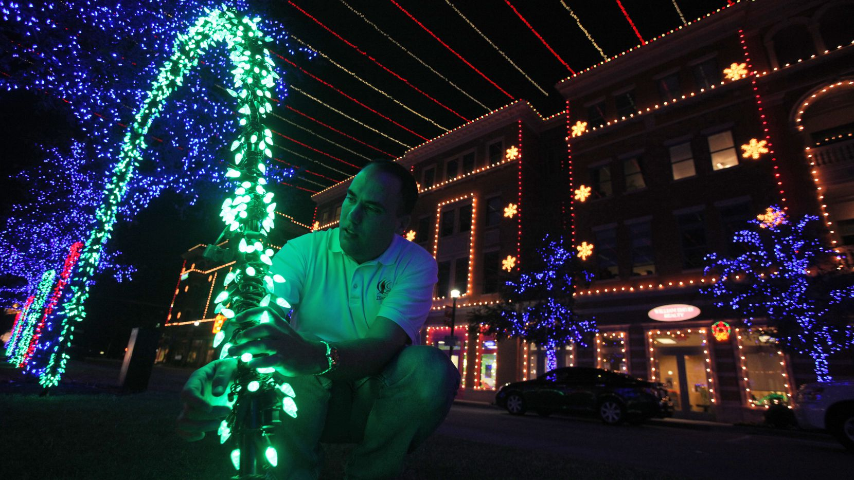 One week out before Frisco's Square light show, Jeff Trykoski checks placement of LED lights at  Frisco Square  November 21, 2010. Trykoski is the man behind the holiday light show set to music that runs in Frisco Square each year.