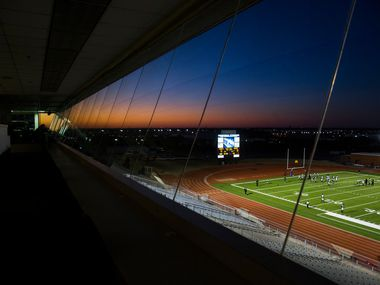 Mansfield Timberview football players can be seen from the press box as they warm up before a UIL Class 5A Division I first-round playoff football game between Mansfield Timberview and Frisco Independence on Thursday, November 14, 2019 at Frisco ISD Memorial Stadium in Frisco.