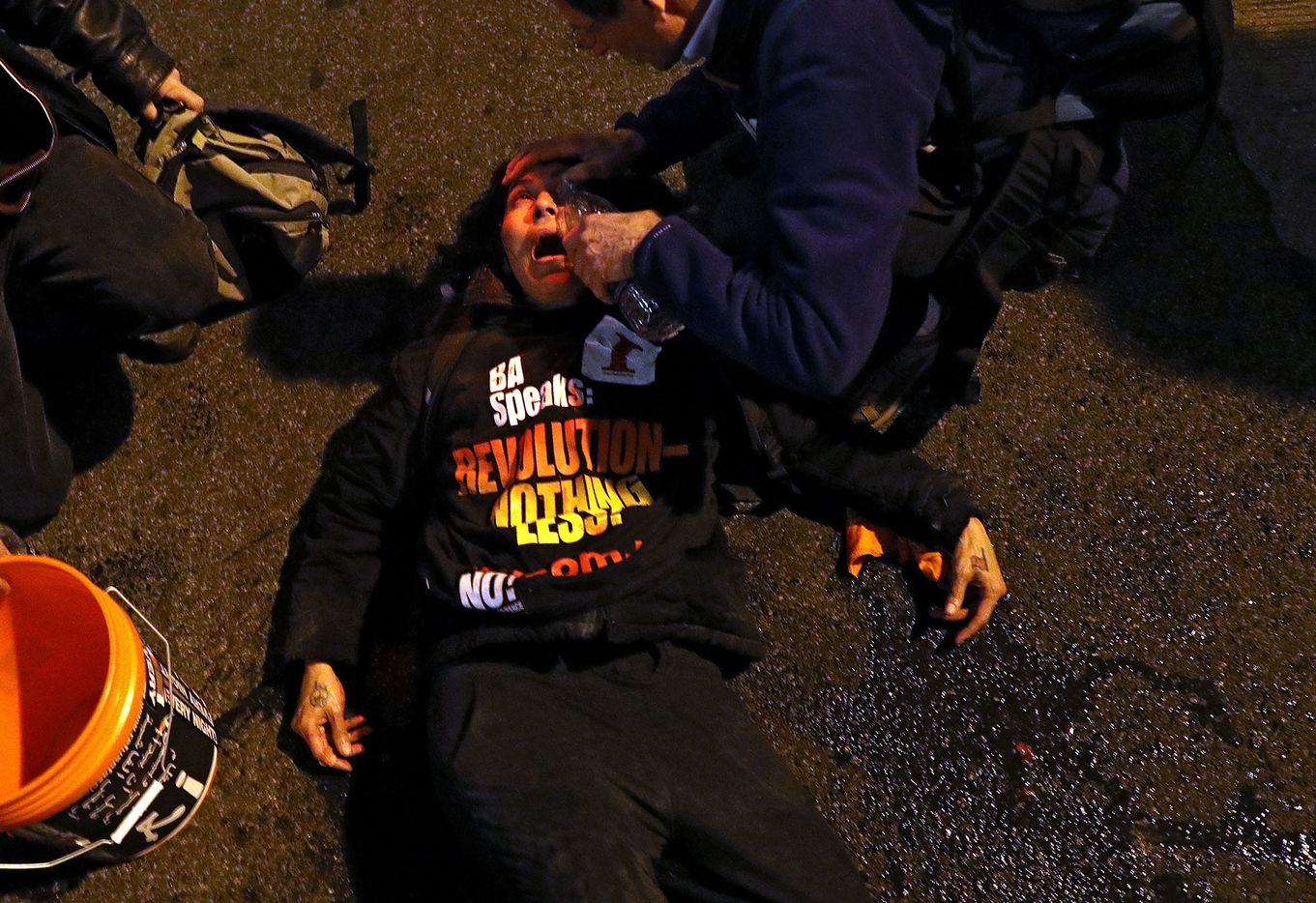 A protester has her eyes doused with water after allegedly being pepper sprayed by police outside of the Deplora Ball at the National Press Building on January 19, 2017 in Washington, DC. Donald Trump will be sworn in as the nation's 45th President on January 20th.