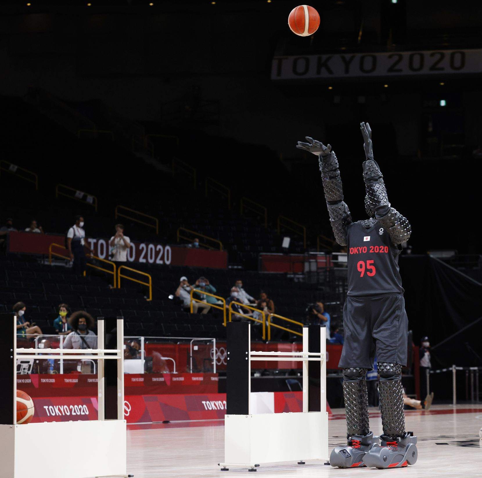 A robot shoots a basketball prior to the start of a game between USA and Australia for a men's basketball semifinal at the postponed 2020 Tokyo Olympics at Saitama Super Arena, on Thursday, August 5, 2021, in Saitama, Japan. USA defeated Australia 97-78 to advance to the gold medal game. (Vernon Bryant/The Dallas Morning News)
