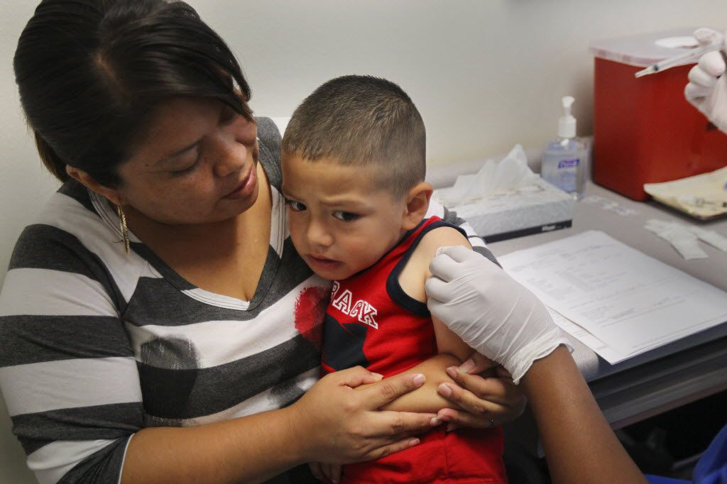 For Jonathan Gotinez, 4, the anticipation was brutal as he  was poised to receive one of four shots at the Dallas Health Department in 2012. (Mona Reeder/The Dallas Morning News)