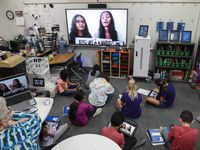Coppell high school juniors Aarushi Jaiswal, left, and Veda Kanamarlapudi, read an Indian folktale titled Sukhu and Dukhu via Zoom, to a dual language elementary students at W.H. Wilson Elementary in Coppell, on Monday, April 19, 2021. The Coppell high school juniors are translating Indian children stories into Spanish so dual language students can understand it.