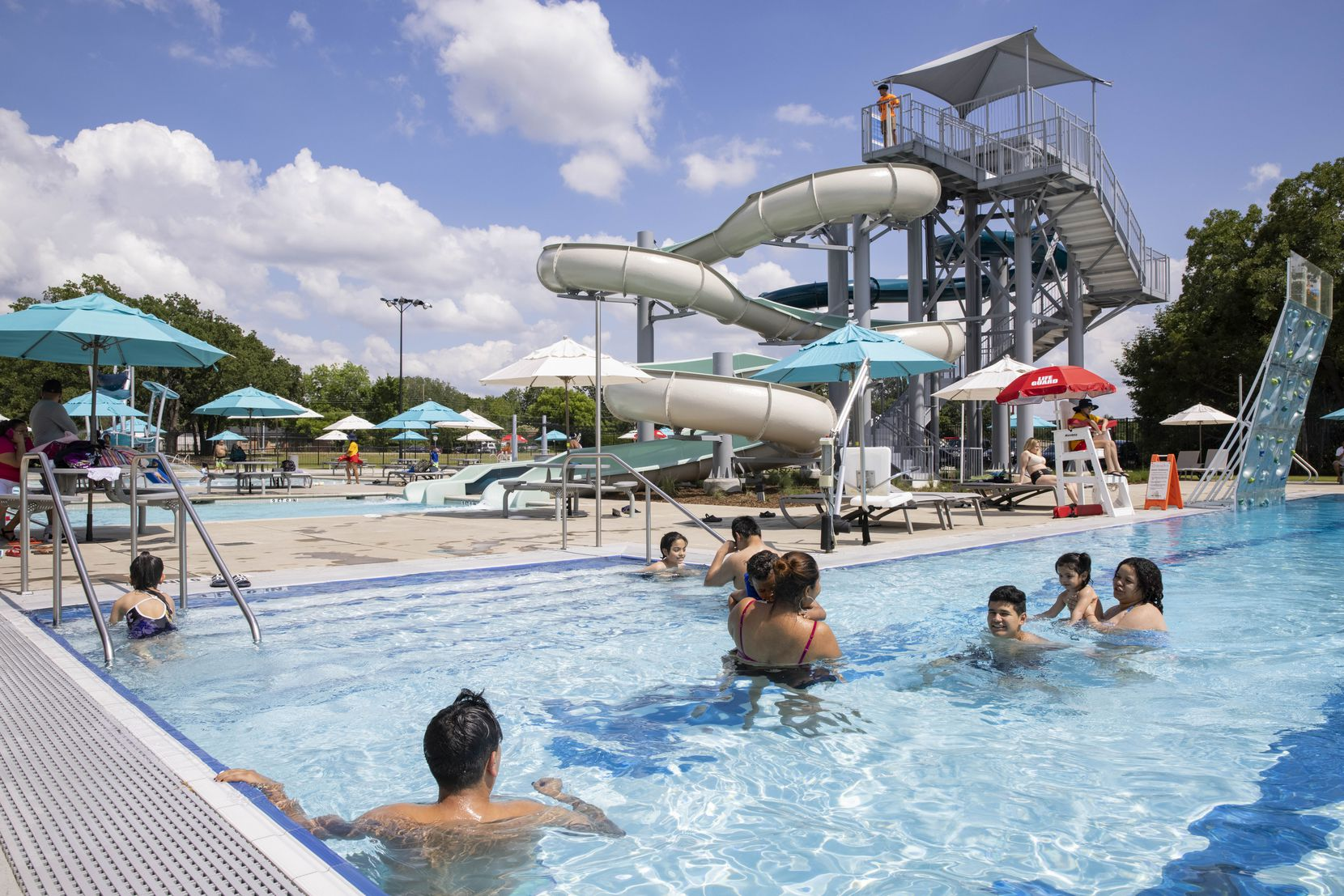 Families enjoy a sunny afternoon at the Cove Aquatic Center at Crawford.