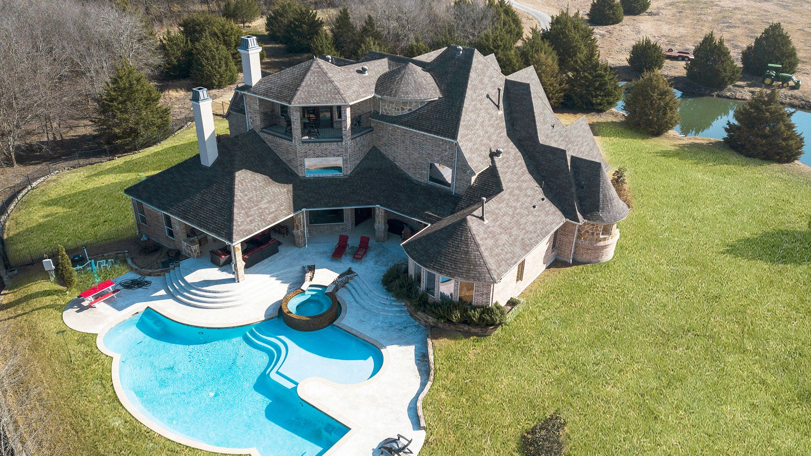 The estate at 100 Serene Haven in McLendon Chisholm offers an abundance of amenities and is offered at $2,499,999.