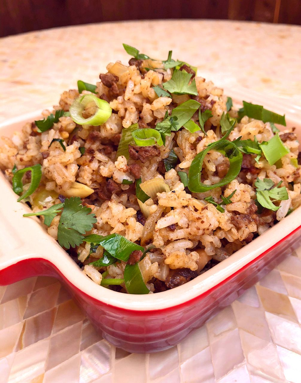 Chicken livers and gizzards make Dirty Rice so good, says Tiffany Derry, chef and owner of Roots Chicken Shak in Plano