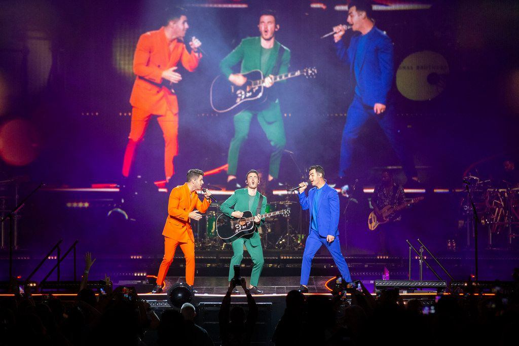 Jonas Brothers members Nick Jonas, left, Kevin Jonas, middle, and Joe Jonas, right, perform at American Airlines Center in Dallas, Texas on Sept. 25, 2019.