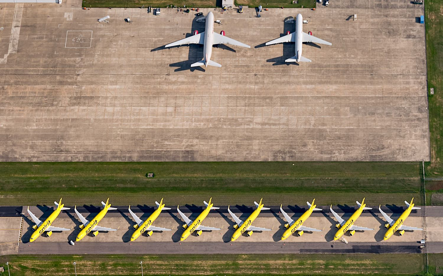 Grounded Spirit Airlines jets at Fort Worth Alliance Airport that Andy Luten photographed from a helicopter for a project about parked airline jets across the country.