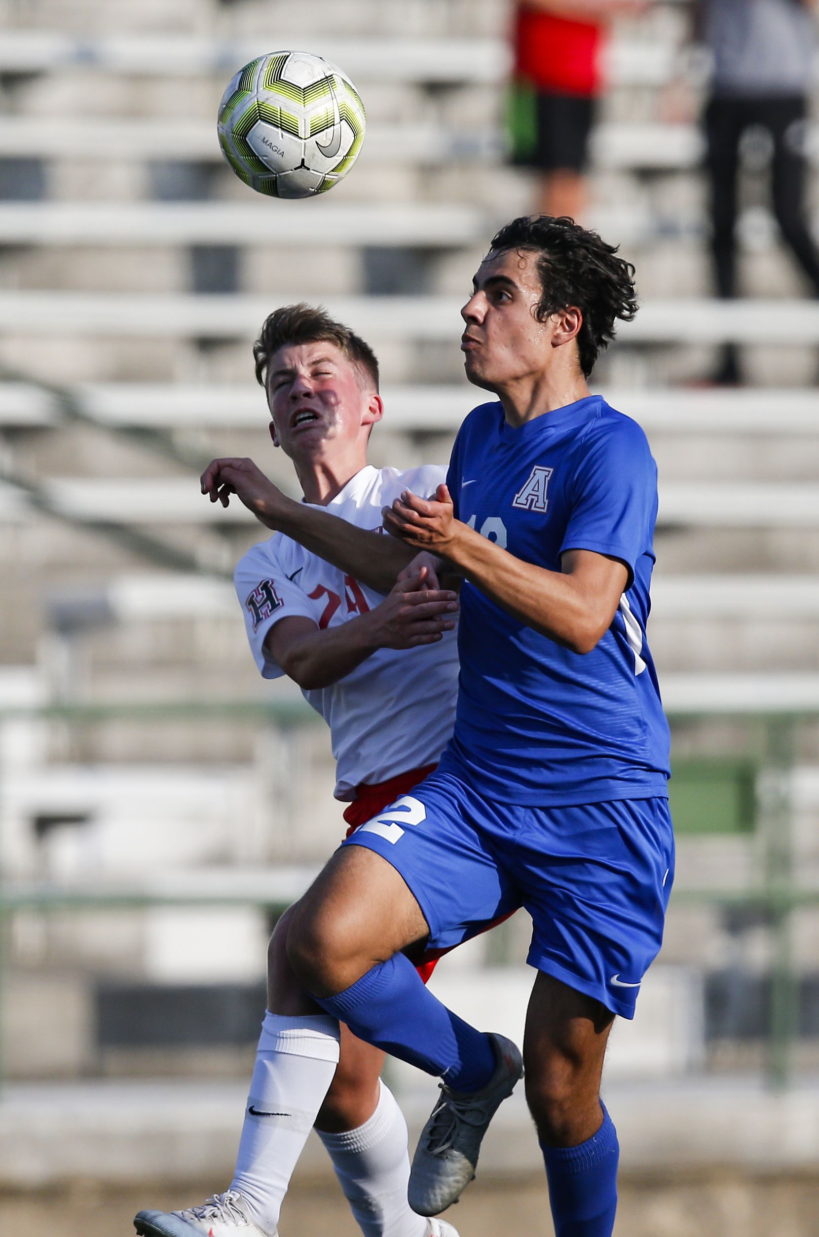 Rockwall-Heath freshman midfielder Andrew Cooley, left, and Allen senior midfielder David Sajdak battle for the ball during the first half of a boys soccer Class 6A state semifinal at Mesquite Memorial Stadium in Mesquite, Tuesday, April 13, 2021. (Brandon Wade/Special Contributor)
