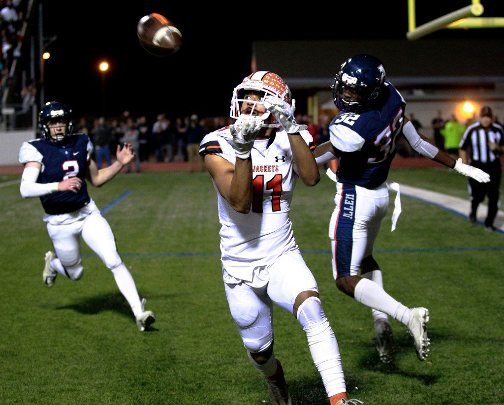 Rockwall's Jaxon Smith-Njigba (11) zeros in on a pass for a touchdown during the first quarter of the Class 6A Division I Region II  area-round football playoff game at Williams Stadium in Garland on Friday, November 23, 2018. (John F. Rhodes / Special Contributor)