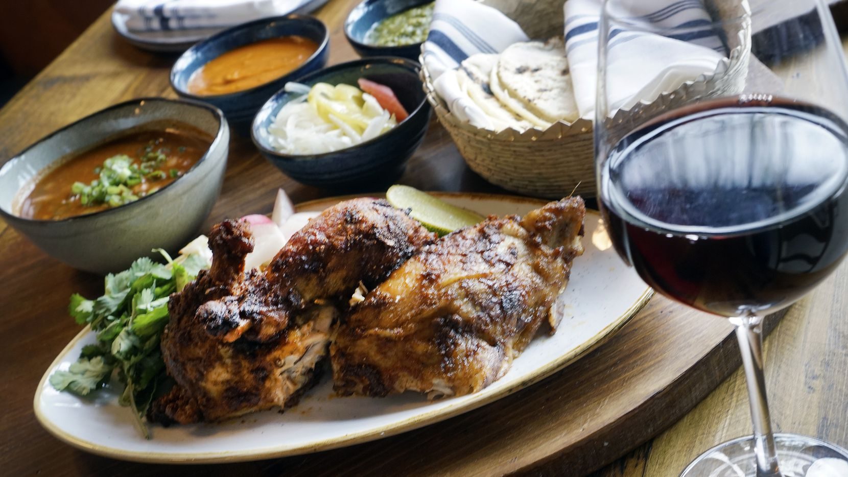 Tinie's in Fort Worth is inspired by the food in Mexico City. Menu items include rotisserie chicken with picante beans.