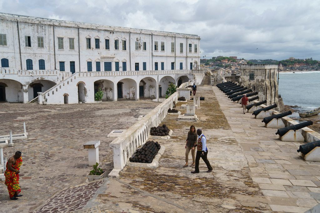"First lady Melania Trump and Cape Coast Castle museum educator Kwesi Essel-Blankson tour Cape Coast Castle on the Gulf of Guinea in Cape Coast, Ghana, Wednesday, Oct. 3, 2018. Cape Coast Castle was a ""slave castle"" used in the trans-Atlantic slave trade. Mrs. Trump is visiting Africa on her first solo international trip."