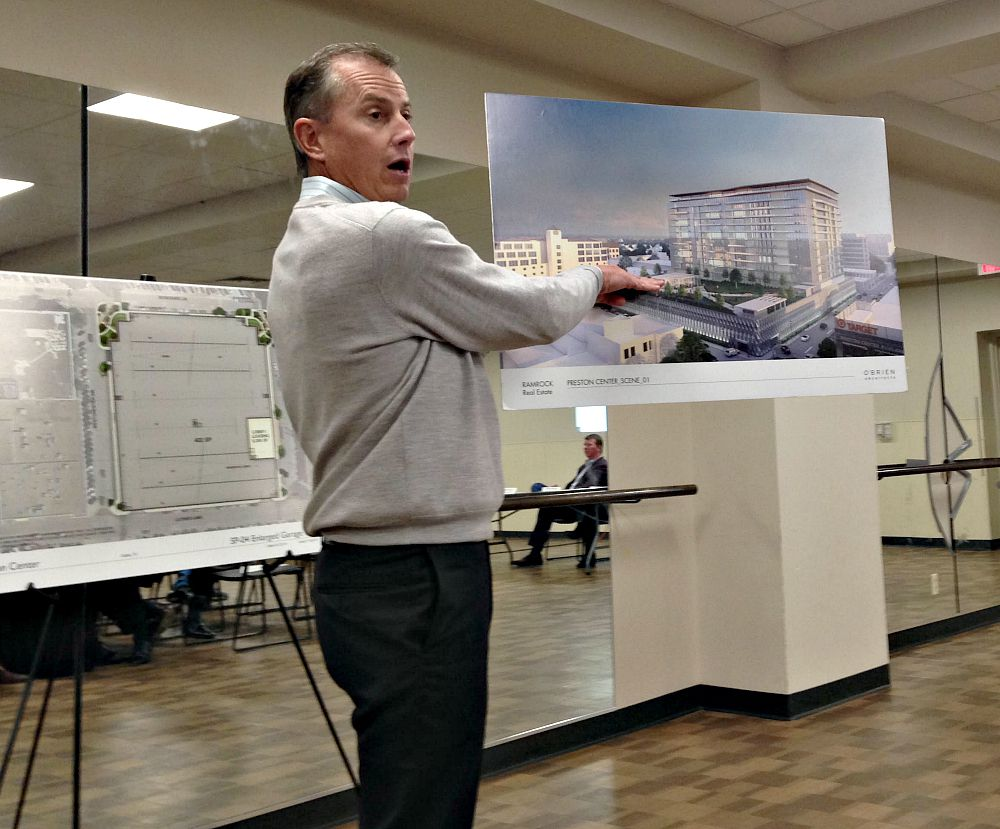 Here is Robert Dozier showing off his renderings Thursday night. Yes. That's Preston Center.
