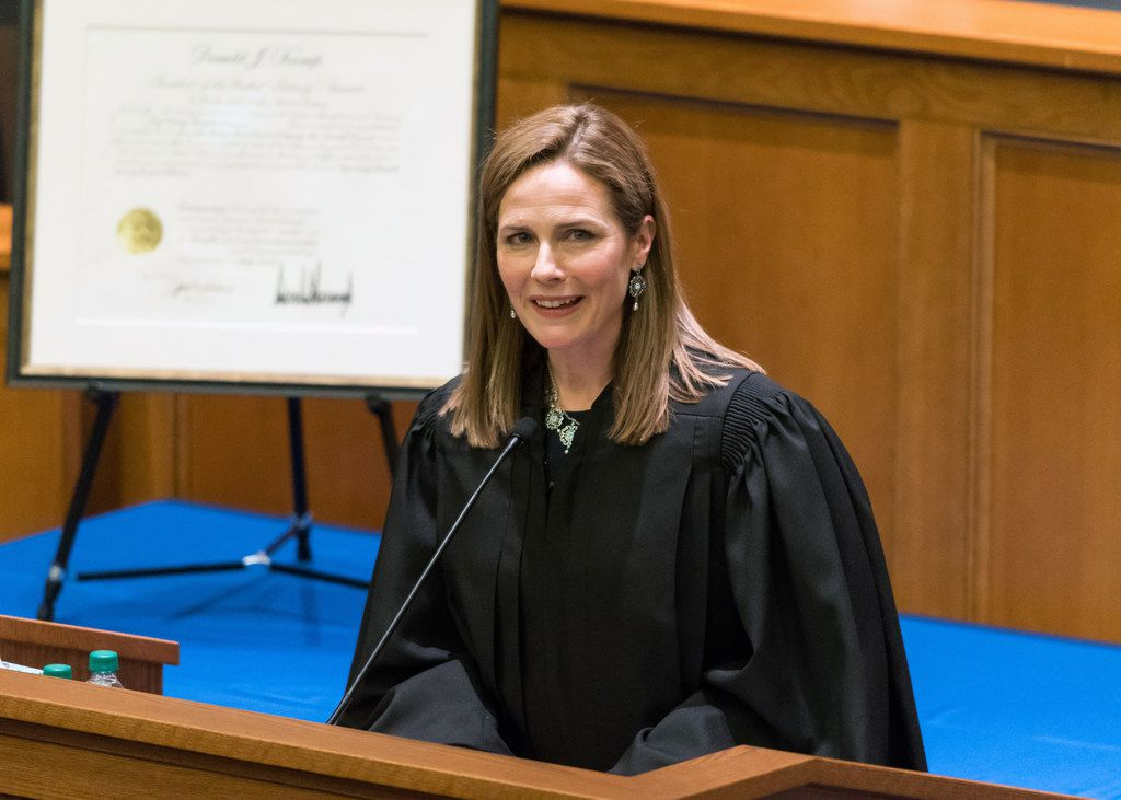 Amy Coney Barrett speaks during a ceremony for her investiture as a judge for the U.S. Court of Appeals for the Seventh Circuit in February 2018 at Notre Dame Law School in South Bend, Ind. (Julian Velasco via The New York Times)