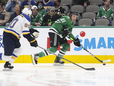 St. Louis Blues center Ryan O'Reilly (90) chases Dallas Stars left wing Jason Robertson (21) during the first period of a Dallas Stars preseason game against St. Louis Blues on Tuesday, Oct. 5, 2021, at American Airlines Center in Dallas.