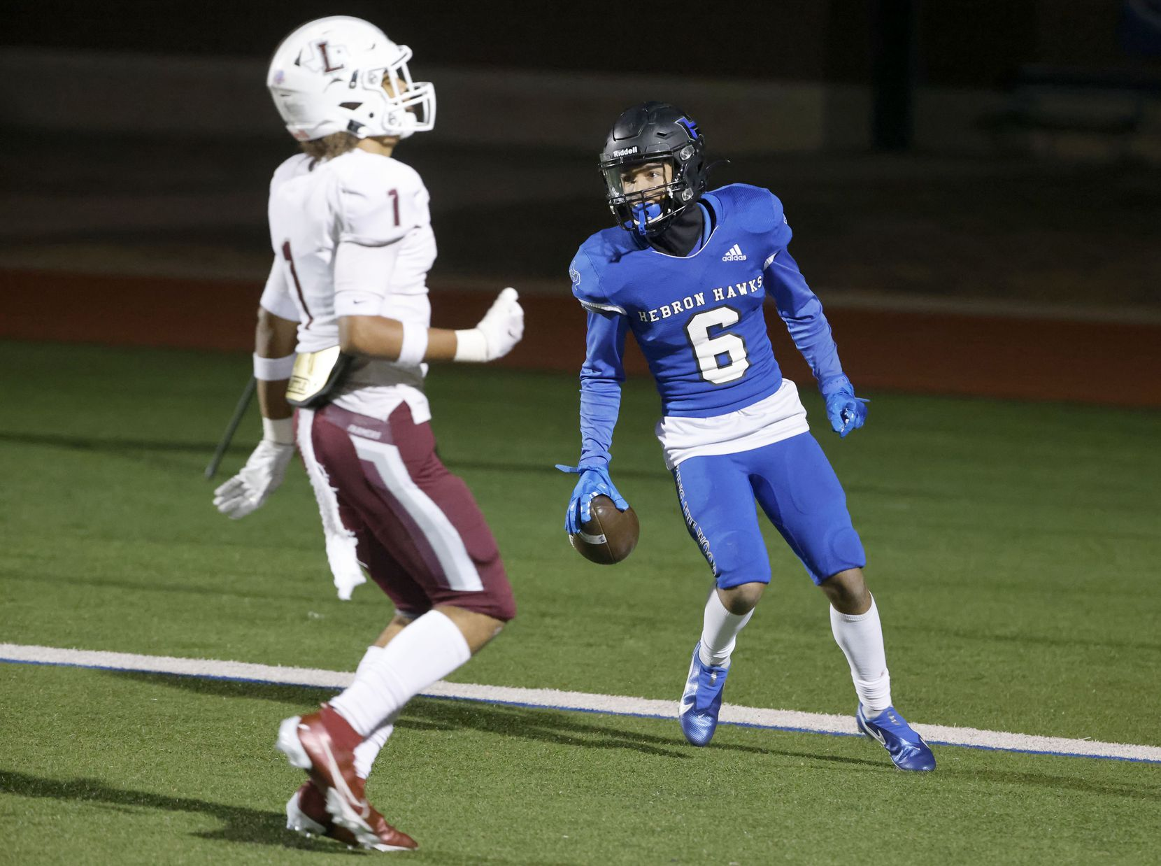 Hebron's Takoda Bridges (6) celebrates his reception for a touchdown in front of Lewisville's Jaydan Hardy (1) during their District 6-6A high school football game on Dec. 4, 2020. (Michael Ainsworth/Special Contributor)