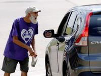 "A panhandler worked a Dallas intersection last September. Some city council members want the proposed budget to address problems with increased ""aggressive panhandling."""