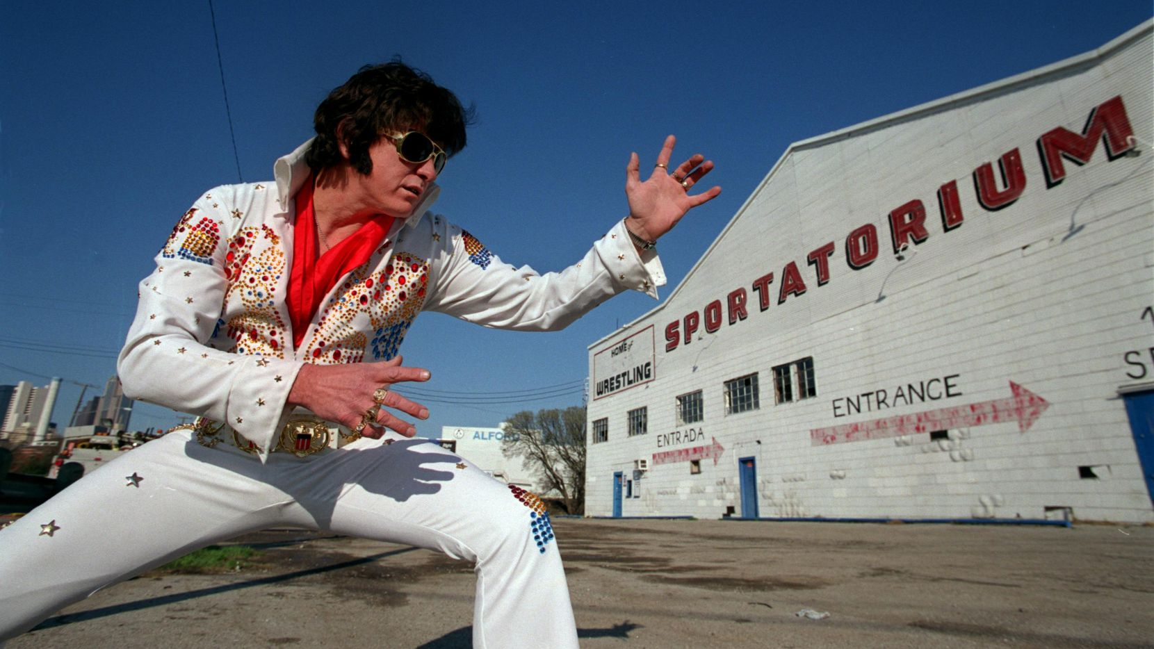 An Elvis impersonator posed outside the Sportatorium, where Elvis Presley played several times in the mid-'50s before the building was demolished.