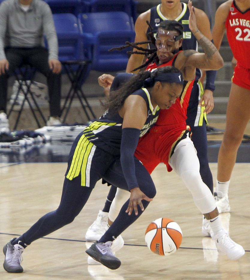 Dallas Wings guard Arike Ogunbowale (24) drives into the defense of Las Vegas guard Riquna Williams (2) during first half action. Las Vegas defeated Dallas 95-79. The two WNBA teams played their game at College Park Center on the campus of UT-Arlington on July 11, 2021. (Steve Hamm/ Special Contributor)