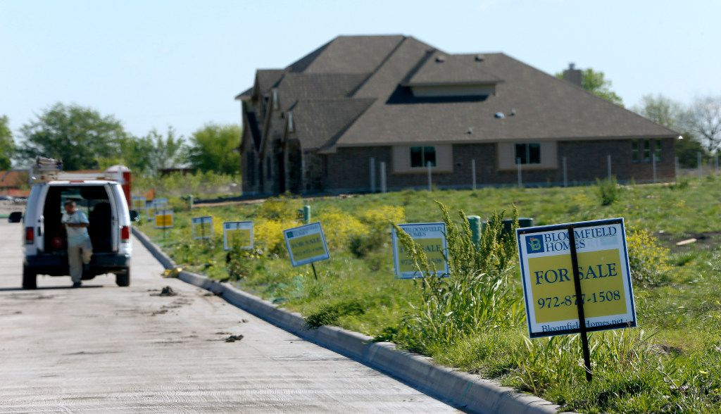 For-sale signs are seen on empty lots in the Hagan Hill development in Mesquite. (Jae S. Lee/The Dallas Morning News)