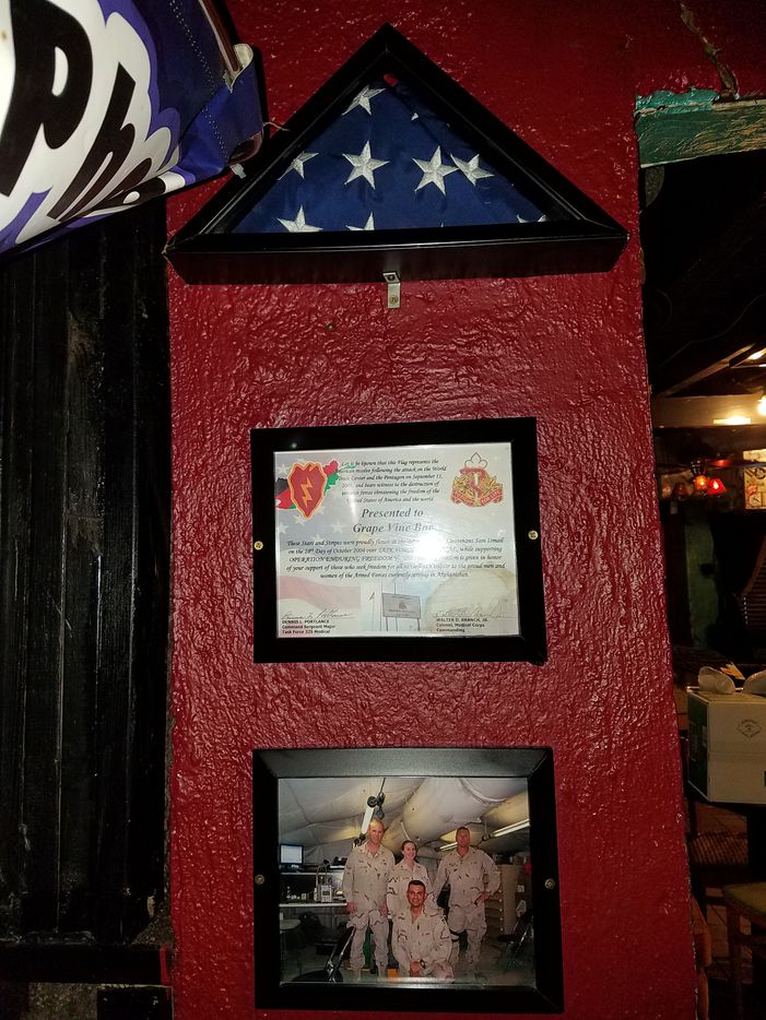 One of Michelle Honea's most cherished decorative items is an American flag presented by First Lt. Sam Ismail. It was flown over Task Force 325 Medical.