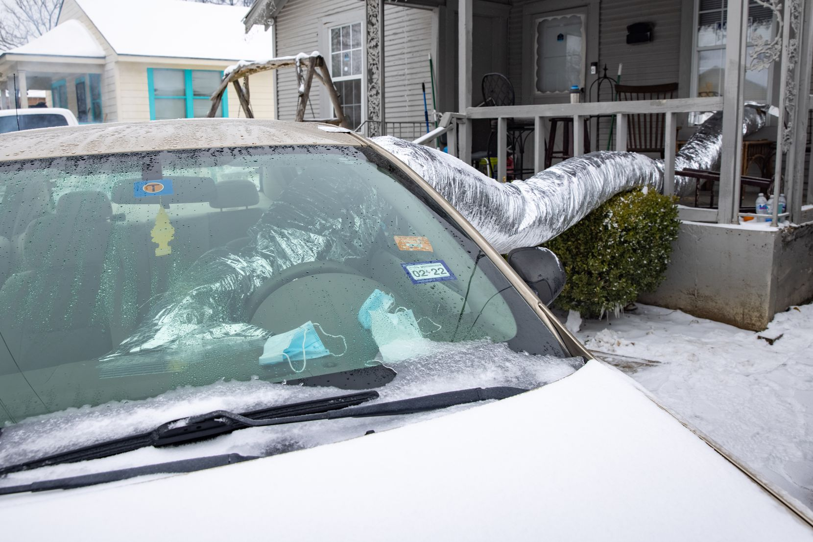 Leonel Solis and Estefani Garcia devised a way last week to move heat from their car's heating system into their East Dallas home to stay warm.