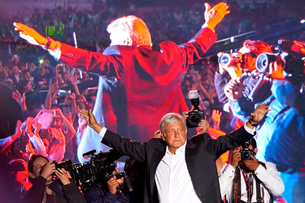 In this Wednesday, June 27, 2018, photo, presidential candidate Andrés Manuel López Obrador waved to supporters at his closing campaign rally in Mexico City. The 64-year-old candidate universally called AMLO has been called Mexico's Donald Trump because of his populist style.  (AP Photo/Ramon Espinosa)