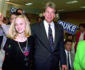 Duke and his daughter Erika enter an election night rally in Kenner, La., in 1992. (AP Photo)
