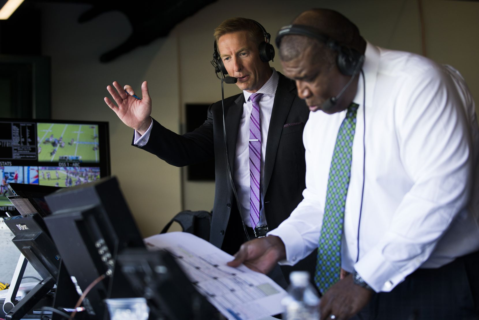 FOX Sports broadcasters Joel Klatt (left) and Curt Menefee call an XFL game between the Dallas Renegades and the New York Guardians on Saturday, March 7, 2020 at Globe Life Park in Arlington. (Ashley Landis/The Dallas Morning News)