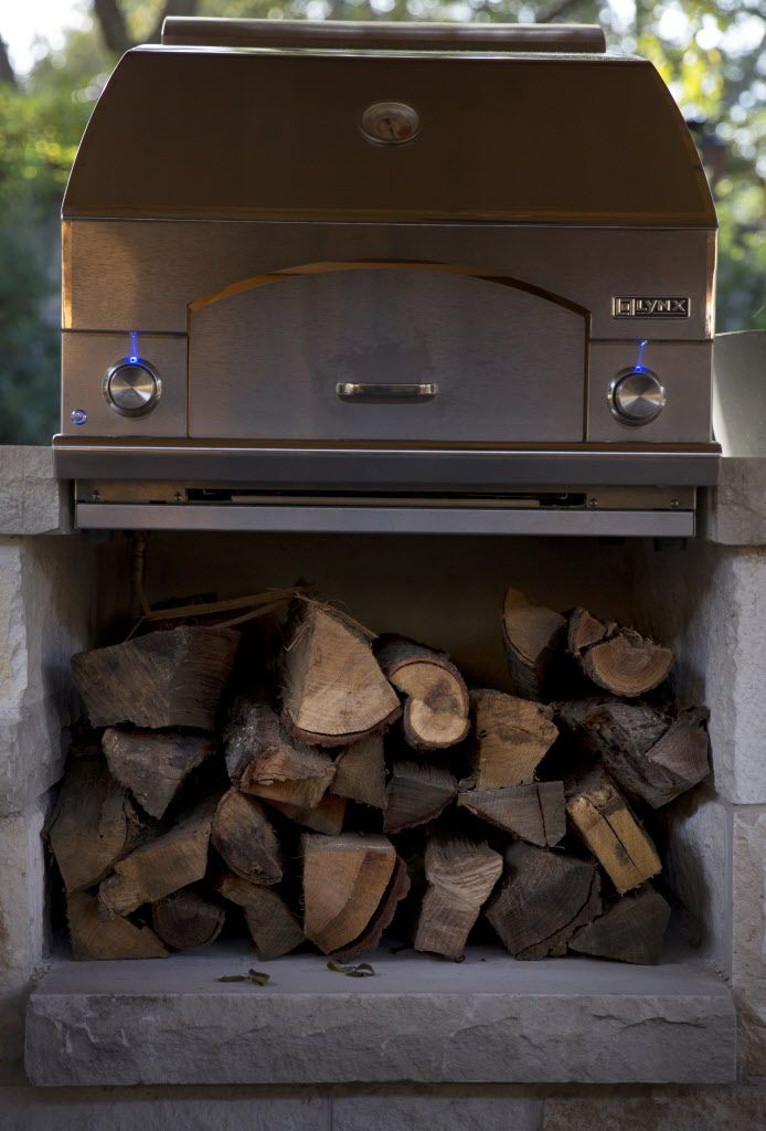 Wood sits under a stove in the outdoor cooking area at chef Kent Rathbun's home.