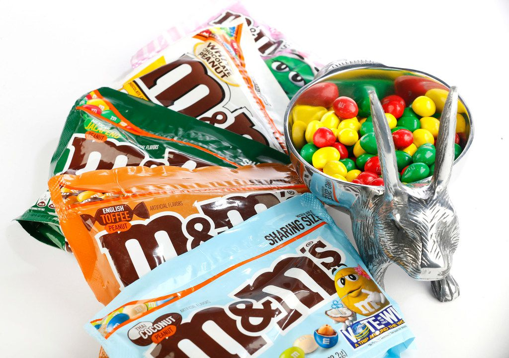 Peanut M&M's Easter candy flavors include, from bottom, Thai Coconut, English Toffee, Mexican Jalapeno (in bowl), and White Chocolate