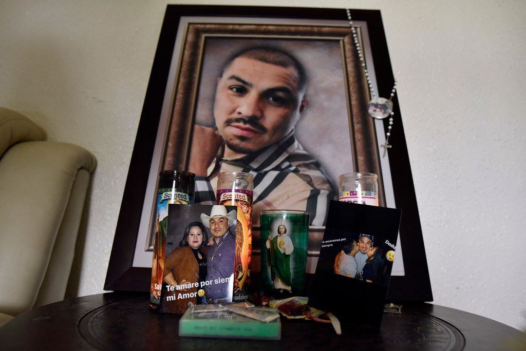 A small memorial paying tribute to the father has its own table in the family's home in southern Dallas.