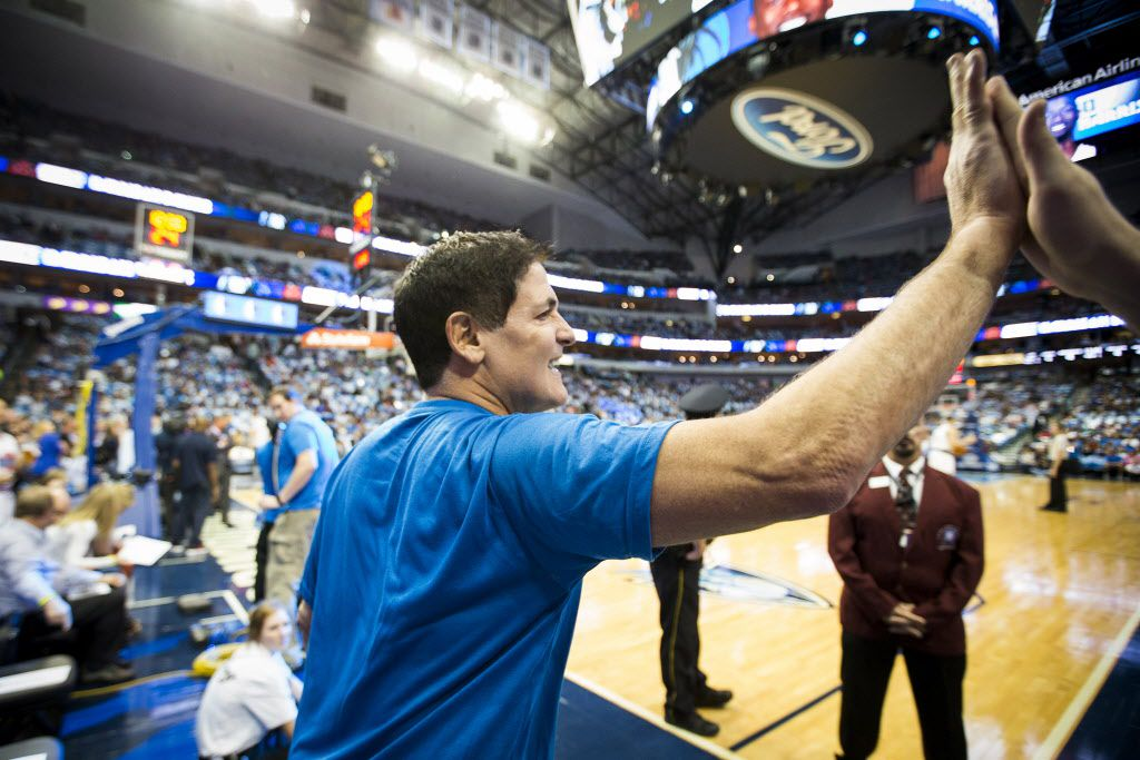 Dallas Mavericks owner Mark Cuban high fives courtside fans before an NBA basketball game against the Houston Rockets at American Airlines Center on Friday, Oct. 28, 2016, in Dallas. (Smiley N. Pool/The Dallas Morning News)