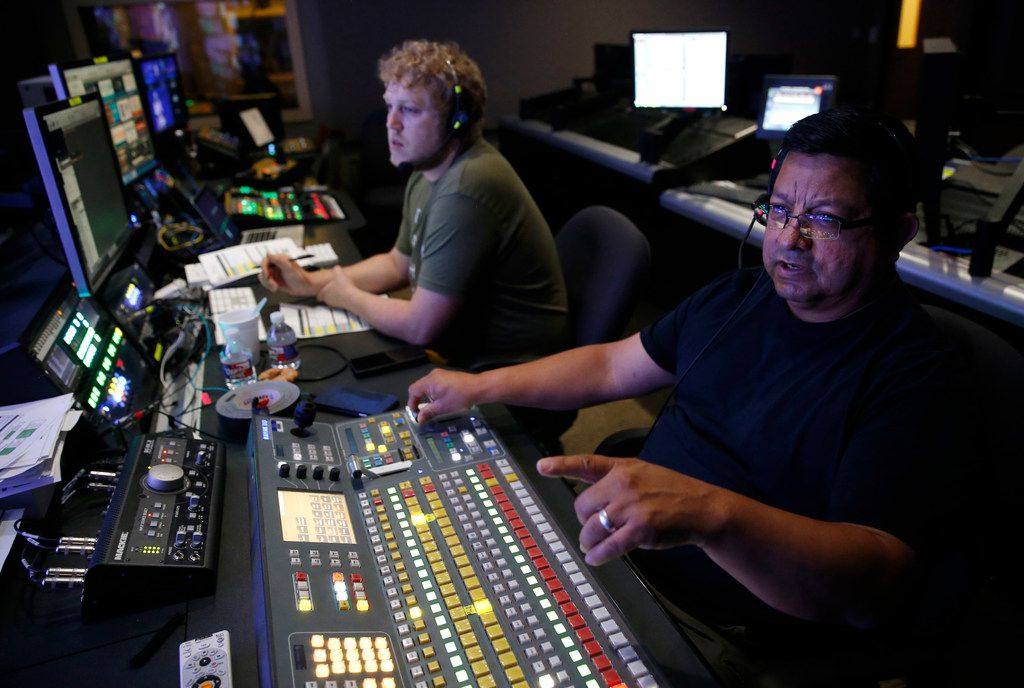 Manuel Vasquez (right), a volunteer, works with video engineer Daniel Merchen during a Sunday service at Watermark.
