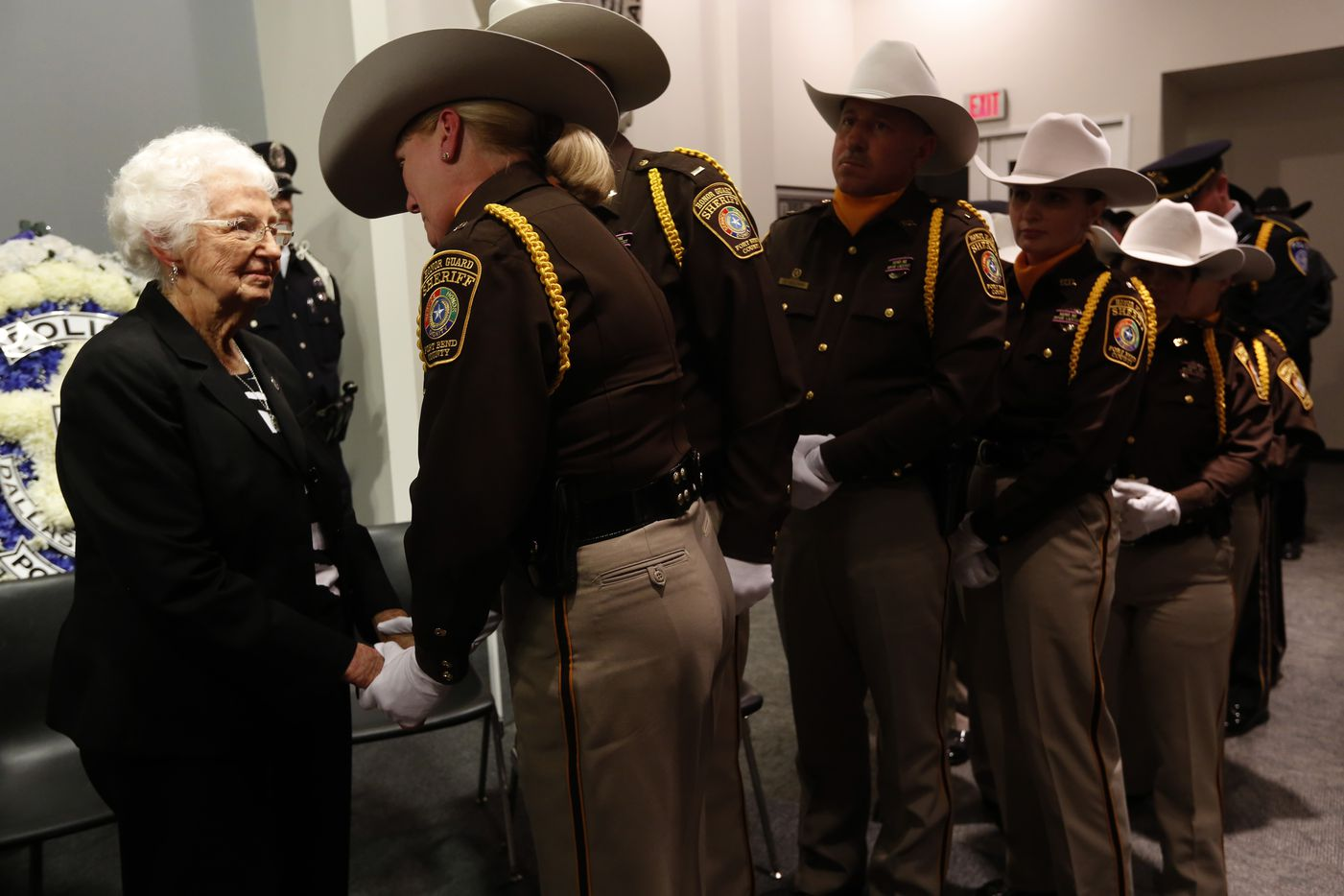 Police officers from around Texas wait in line to shake the hand of Marie Tippit, widow of slain Dallas police Officer J.D. Tippit, at Dallas Police Association headquarters on Nov. 22, 2013, 50 years to the day that President John F. Kennedy and Officer Tippit were killed.