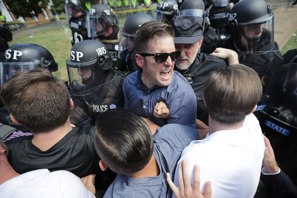 "CHARLOTTESVILLE, VA - AUGUST 12:  White nationalist Richard Spencer (C) and his supporters clash with Virginia State Police in Lee Park after the ""Unite the Right"" rally was declared an unlawful gathering August 12, 2017 in Charlottesville, Virginia. Hundreds of white nationalists, neo-Nazis and members of the ""alt-right"" clashed with anti-fascist protesters and police as they attempted to hold a rally in Lee Park, where a statue of Confederate General Robert E. Lee is slated to be removed. (Photo by Chip Somodevilla/Getty Images) *** BESTPIX ***"