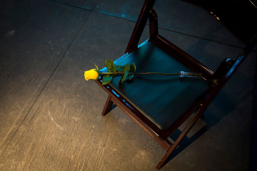 A rose sits on a single chair, placed on the stage to symbolize fallen law enforcement officers, during a campaign event for  Sen. Ted Cruz at River Ranch Stockyards on Wednesday, April 4, 2018, in Fort Worth, Texas.