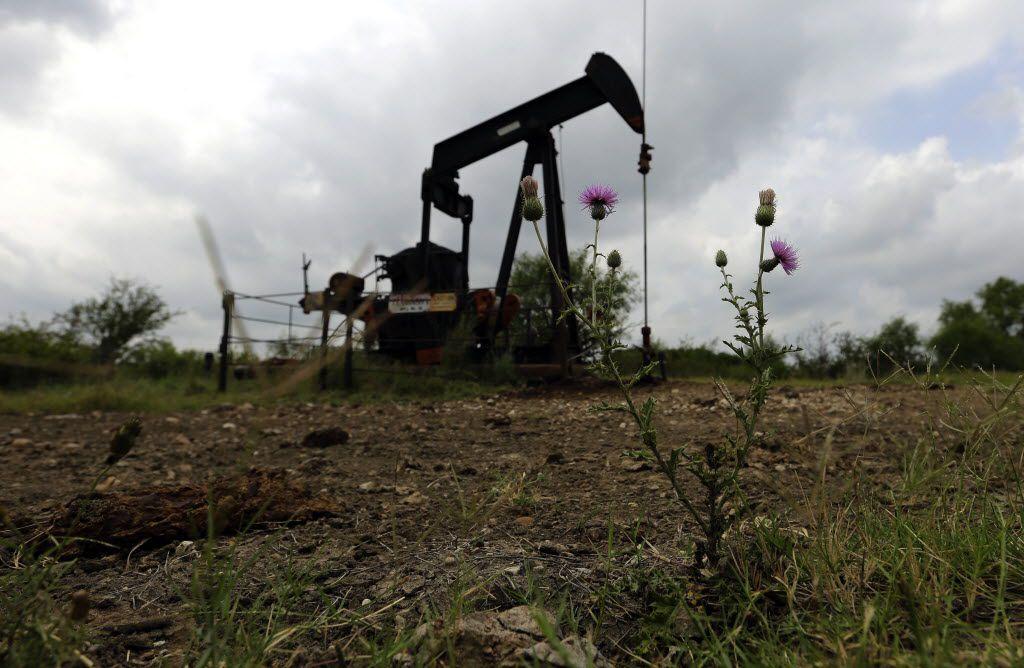 A 2016 photo of an idle pump jack sits idle on a South Texas ranch near Bigfoot, Texas. (AP Photo/Eric Gay)