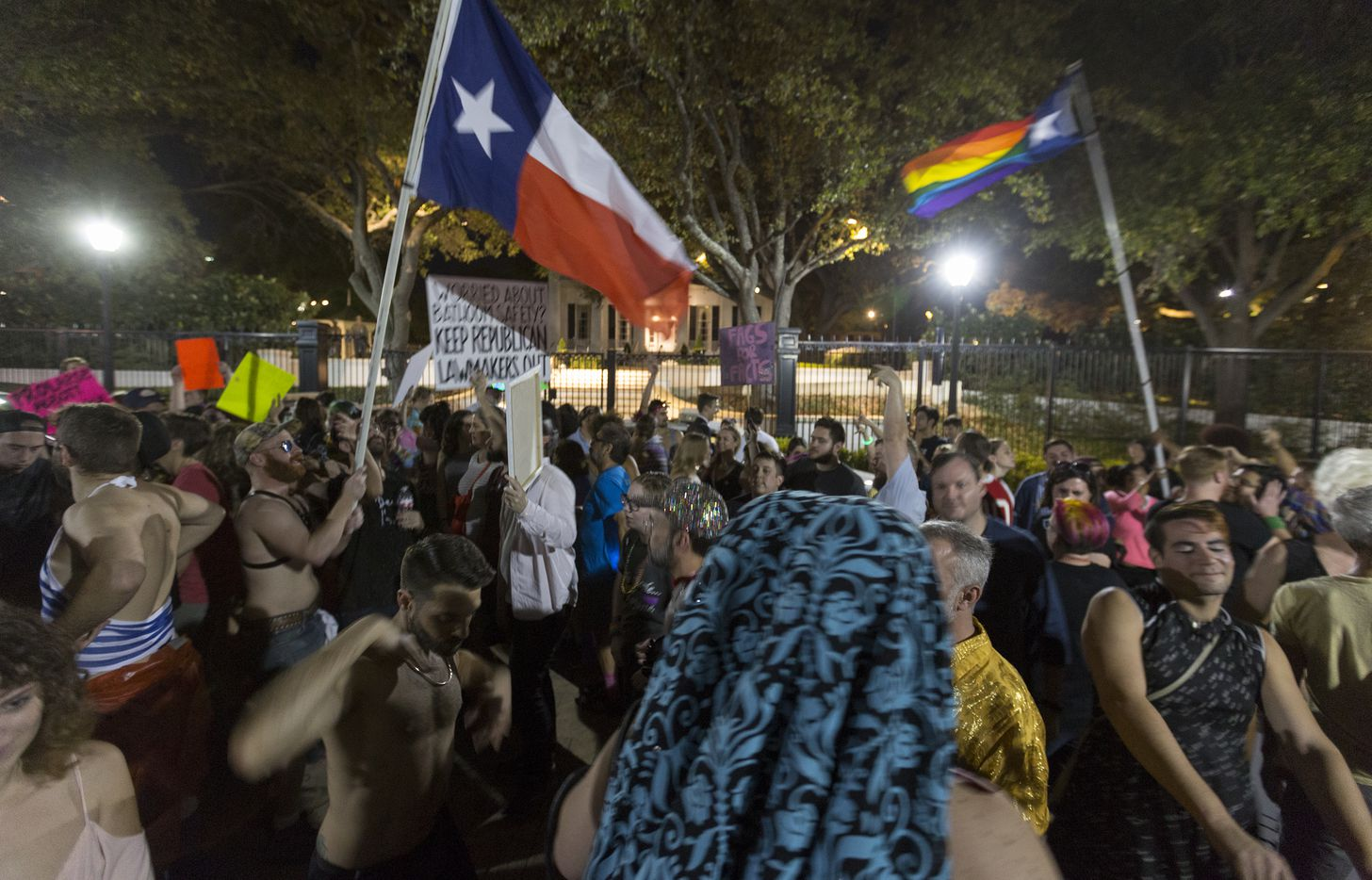Supporters of the LGBTQ community gather for a dance party in front of the Governor's Mansion in Austin on Thursday, Feb. 23, 2017.