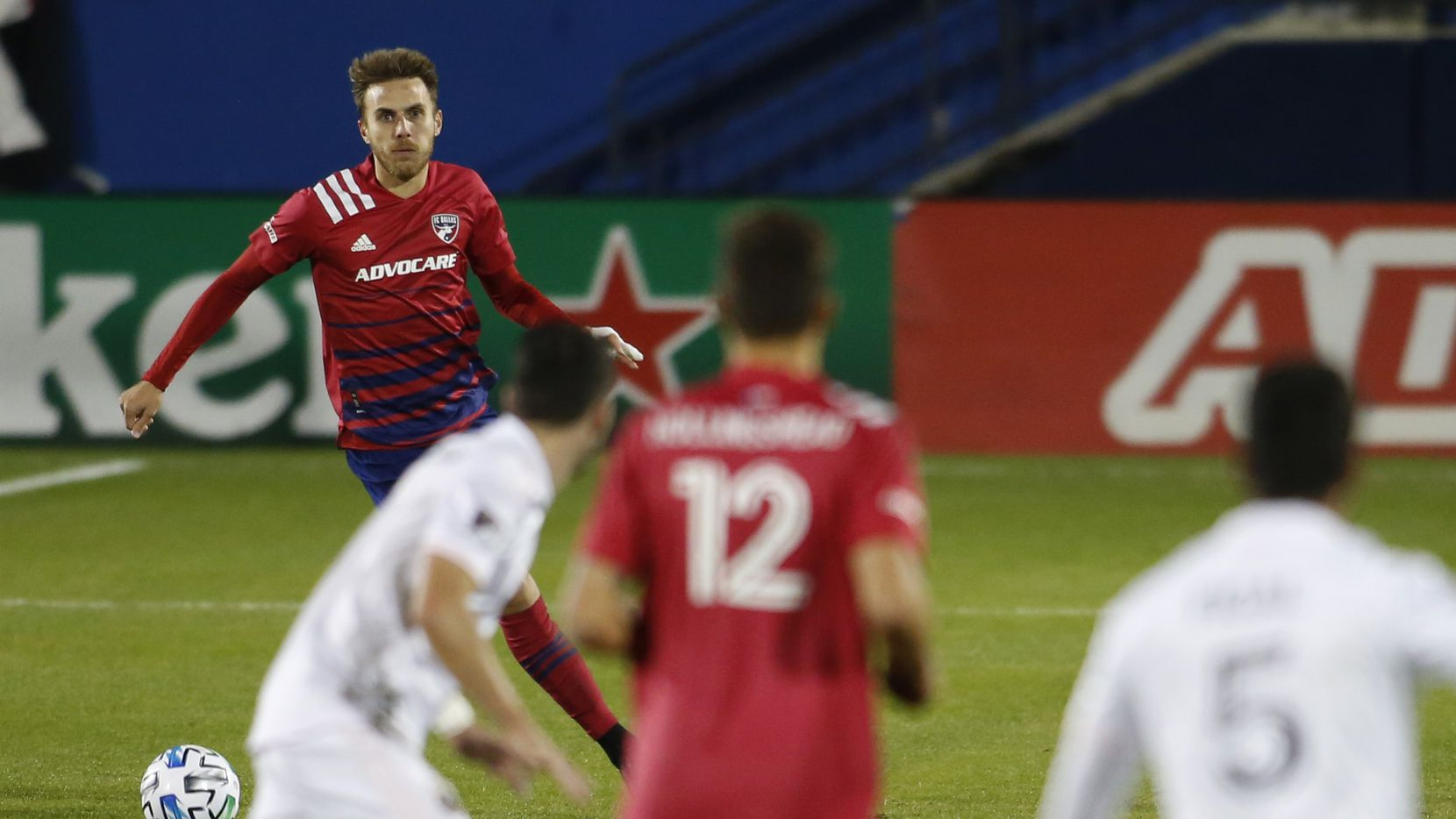 FC Dallas defender Bressan (4) shows fine focus as he surveys the Inter Miami defense as he advances the ball during a first half offensive drive.The two teams played their Major League Soccer match at Toyota Stadium in Frisco on October 28, 2020.
