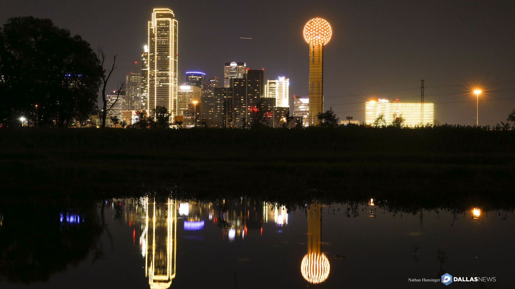 Downtown Dallas buildings lit in gold  in honor of the #BeGolden campaign in Dallas on April 9, 2018.  (Nathan Hunsinger/The Dallas Morning News)