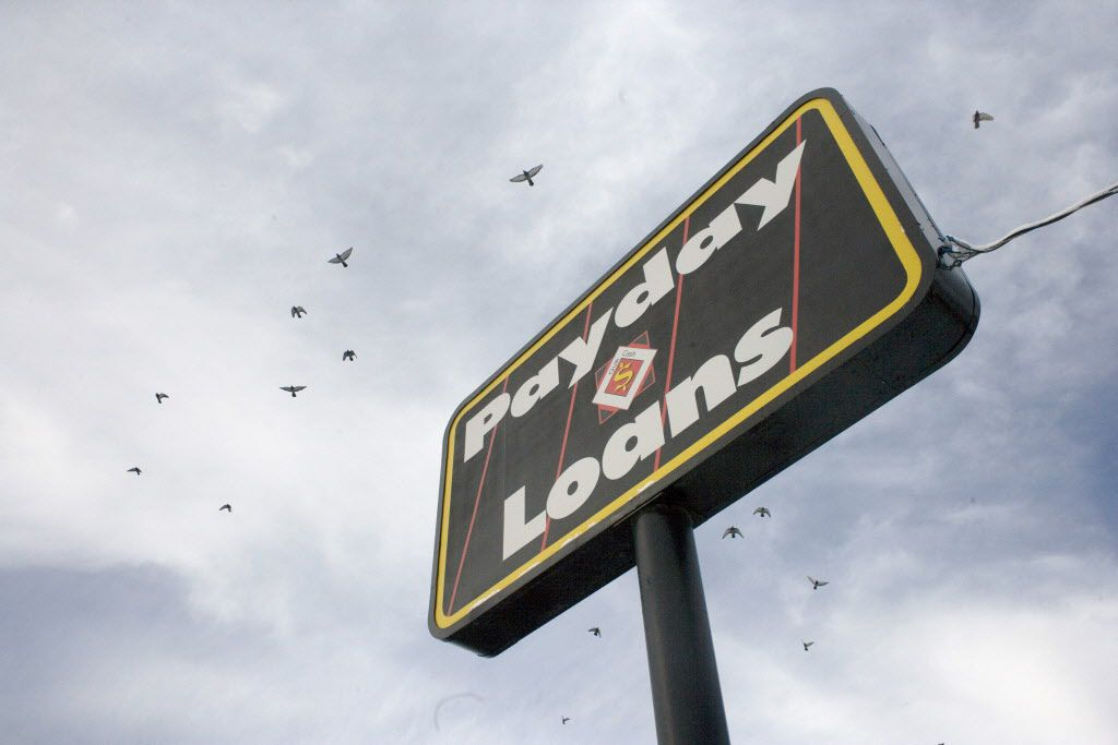 FILE -- A payday loan store on the edge of the Navajo Nation in Gallup, N.M., where a lender could be found on almost every corner, Dec. 18, 2006. Google said on May 11, 2016, that it was no longer going to run payday loan ads, another example of powerful technology companies using their clout to advance their causes in society. (Rick Scibelli Jr./The New York Times)