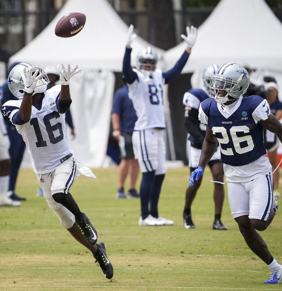 Dallas Cowboys wide receiver Reggie Davis (16) catches a long touchdown pass as cornerback Jourdan Lewis (26) defends during a practice at training camp on Wednesday, Aug. 11, 2021, in Oxnard, Calif.