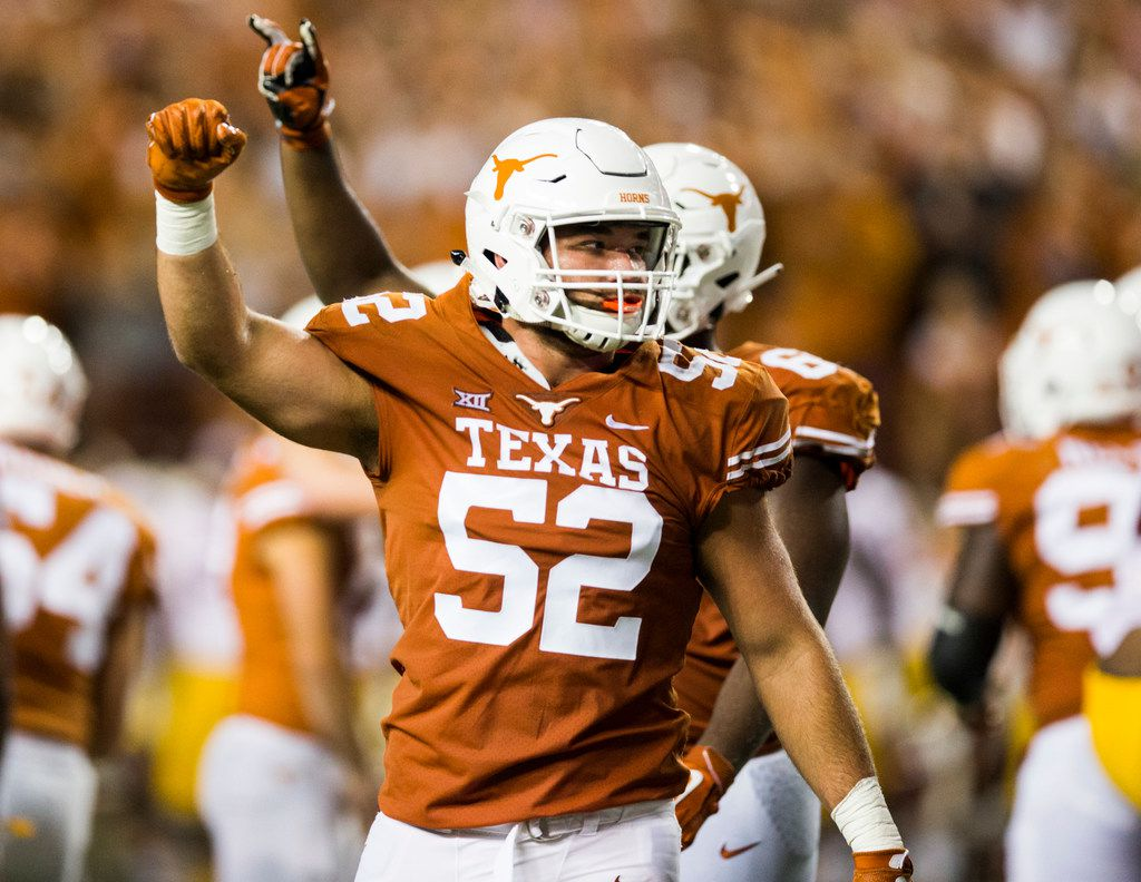 FILE - Texas offensive lineman Samuel Cosmi (52) celebrates a field goal at the end of the second quarter of a game against USC on Saturday, Sept. 15, 2018, at Darrell K Royal Memorial Stadium in Austin.
